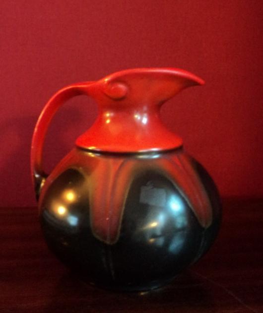 Rood/zwarte kan met druipglazuur motief